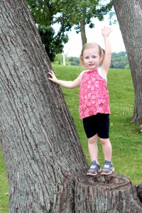 child climbing tree stump