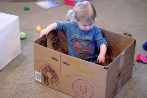 Child in toy car box