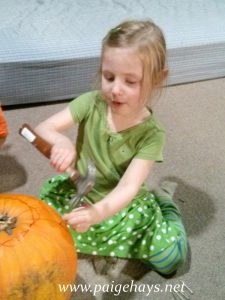 nails into pumpkin